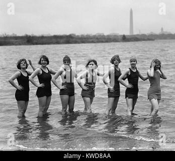 Seven young women in bathing suits in the Potomac River at Arlington Beach, April 29, 1925. In the background is - Stock Photo