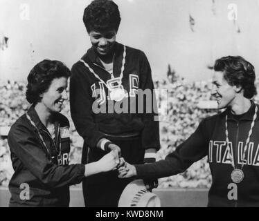 1960 Olympic winners of the women's 100 meter race on victory podium. First is Wilma Rudolph of USA. Dorothy Hyman - Stock Photo