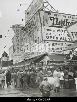 Nathan's Hot Dogs food stand on the Coney Island Boardwalk, May 11, 1954. Brooklyn, New York City. (BSLOC_2015_17 - Stock Photo