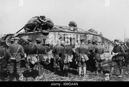 World War 1 Tanks. German soldiers standing on and around a tank with an Iron Cross insignia. It is one of approximately - Stock Photo