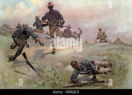 African Americans of Troop C, Ninth US Cavalry, with Capt. Taylor, leading the charge. In the background is the - Stock Photo
