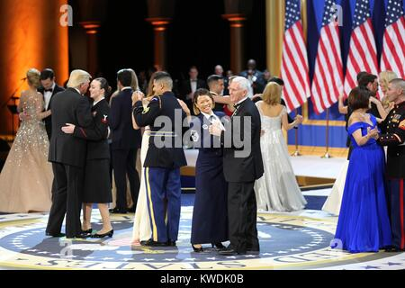 President Donald Trump, VP Mike Pence, and wives dance with the military and first responders. They are at the Salute - Stock Photo