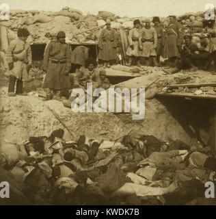 The horrors of modern war! A trench filled with Japanese dead -- in a Russian fort, Port Arthur, was the 1904 caption - Stock Photo