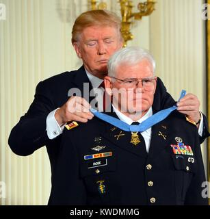 Army Capt. Mike Rose receives the Medal of Honor from President Donald Trump, Oct. 23, 2017. He was awarded for - Stock Photo