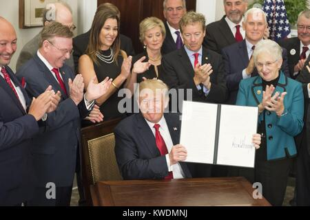 President Donald Trump signs the Executive Order to Promote Healthcare Choice and Competition. Oct. 12, 2017. The - Stock Photo