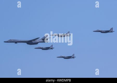 US Air Force B-1B Lancer, escorted by South Korean air force F-15K Slam Eagles, Sept. 13, 2016. The allied aircraft - Stock Photo