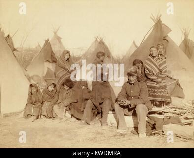 Eleven Miniconjou Lakota (Sioux) in a tipi camp, after the Wounded Knee Massacre of Dec. 29, 1890. They are survivors - Stock Photo