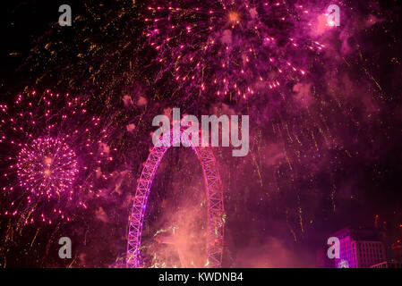 London, UK - January 1st 2018. Fireworks display at the London Eye in the British capital celebrates the end of - Stock Photo