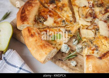 Hot delicous pizza with pear and blue cheese on wooden board. Vegetarian healthy food concept, traditional Italian - Stock Photo