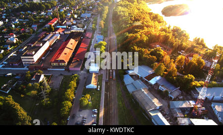 Aerial photo of railroad in city and trees - Stock Photo