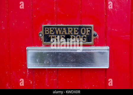 Beware of dog sign on front gate of house above letter box - Stock Photo