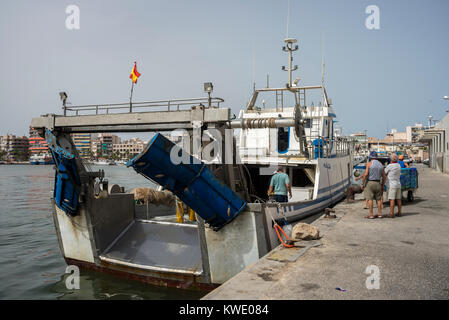 Fishing boats unloading fish in the port of Santa Pola, Alicante, Spain, on July 21, 2016 - Stock Photo