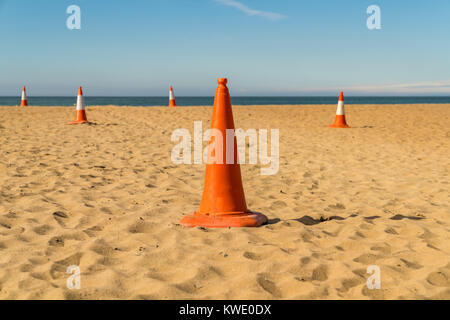 Pylons on the beach, seen in Aberporth Bay, Ceredigion, Dyfed, Wales, UK - Stock Photo