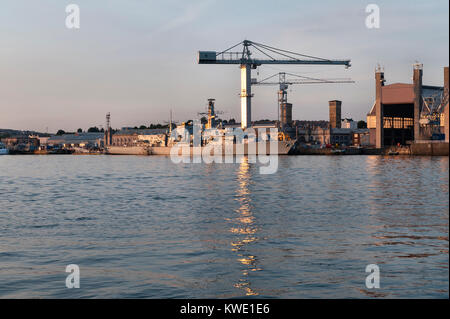 The Devonport Royal Dockyard, Plymouth, Devon, UK with HMS Montrose, a Type 23 frigate of the Royal Navy. Stock Photo