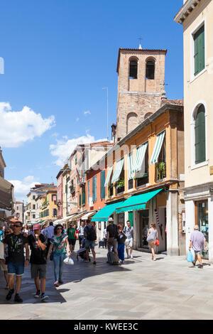 Busy street scene in Strada Nova, Cannaregio, Venice,  Veneto, Italy with Chiesa di Santa Sofia and pedestrians - Stock Photo