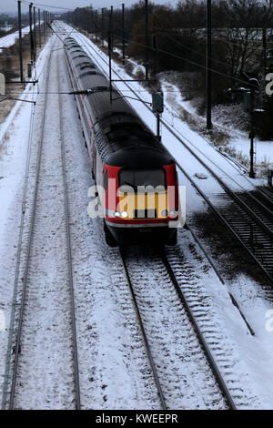 Winter Snow, Virgin Trains, East Coast Main Line Railway, Peterborough, Cambridgeshire, England, UK - Stock Photo