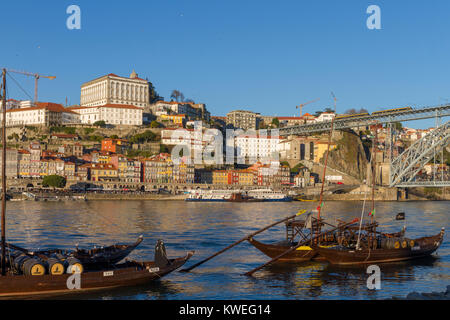 Typical Rabelo boats parked in Douro river in front of Porto city, Portugal - Stock Photo