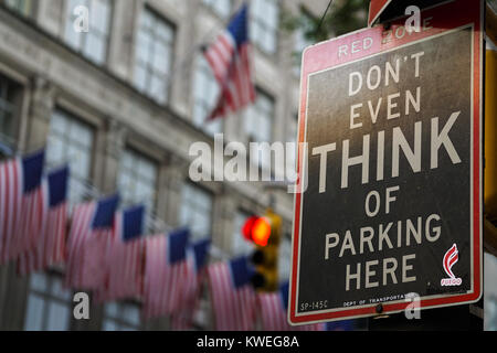 Don't Even Think of Parking Here warning sign on the Fifth Avenue in New York City. - Stock Photo
