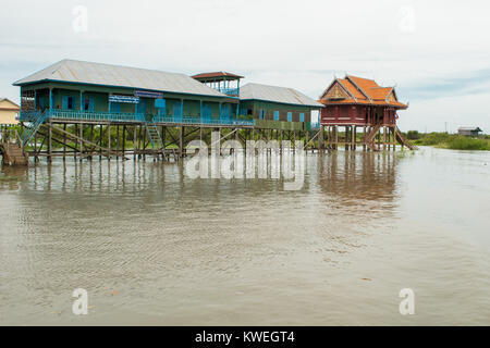 Two buildings, houses on stilts, floating, on the Tonle Sap river lake, in Kampong Phluk village, Siem Reap, Cambodia, - Stock Photo