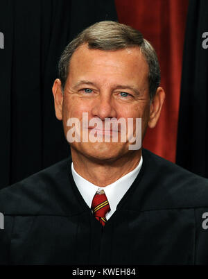 Chief Justice John G. Roberts smiles as The Supreme Court Justices of the United States sit for a formal group photo - Stock Photo