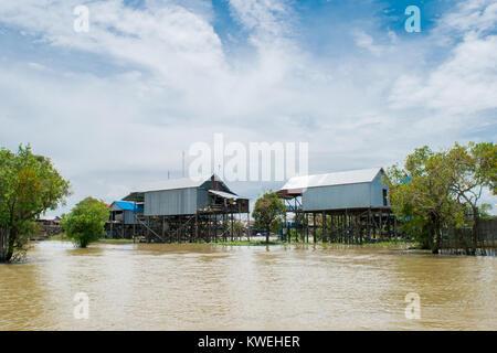 Houses in Kampong Phluk floating village, suspended on stilts over water of Tonle Sap Great Lake floodplain, near - Stock Photo