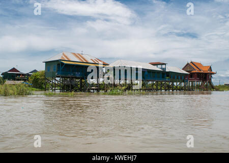 Buildings, houses on stilts, floating, on the Tonle Sap river lake, in Kampong Phluk village, Siem Reap, Cambodia, - Stock Photo