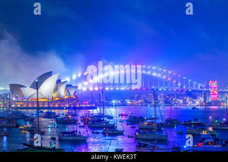 Australia celebrates the arrival of 2018 with New Years Eve fireworks on Sydney Harbour. The popular annual event - Stock Photo
