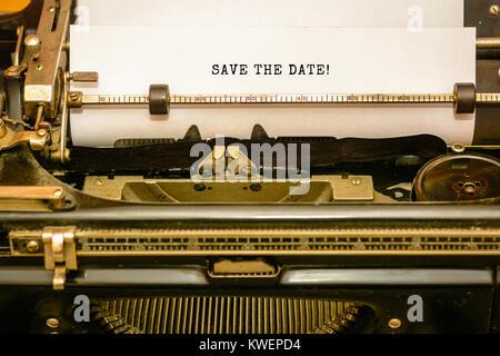 SAVE THE DATE - written on old typewriter machine - Stock Photo