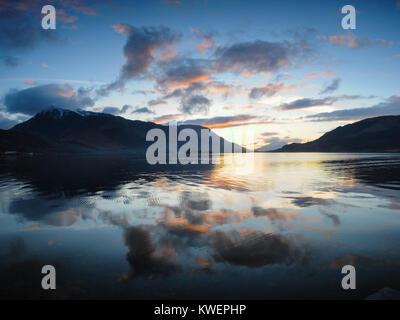 Sunset behind Beinn a'Bheithir and Ballachulish seen across Loch Leven from Glencoe, Scotland - Stock Photo