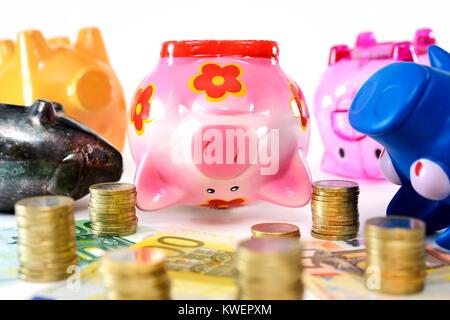 Dead piggy banks, symbolic photo negative interest, Tote Sparschweine, Symbolfoto Negativzinsen - Stock Photo