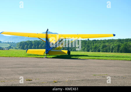 A small yellow plane ready for takeoff, seen at Hahnweide, Stuttgart, south Germany, June 2017 - Stock Photo