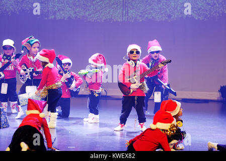 Three and four year olds singing and dancing, giving their christmas show - Stock Photo