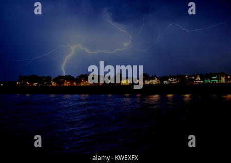 Thunder storm over the town of Deal on 18th July 2014, taken from Deal Pier at night... - Stock Photo
