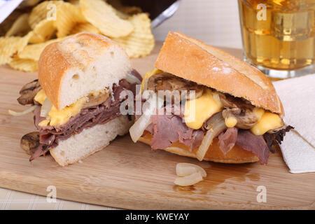 Sliced roast beef sandwich on a cutting board - Stock Photo