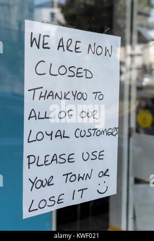 Window sign in high street shop after closing down Metaphor recession, struggling high street, high street crisis, - Stock Photo