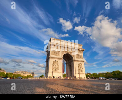 Arc de Triumph in Paris, France, on a bright afternoon with feather clouds behing, panoramic image. - Stock Photo