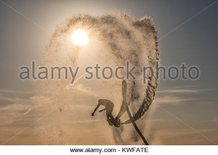 Flyboarding against beautiful sky - Stock Photo
