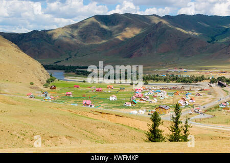 Mongolian countryside  landscape with small colorful, countryside settlement in valley outside the capital Ulaanbaatar, - Stock Photo