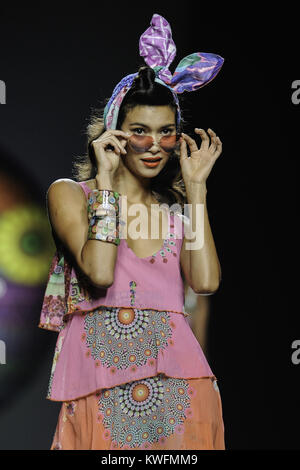 MADRID, SPAIN - SEPTEMBER 11:  Model showcases designs by Desigual on the runway at Desigual show during Mercedes - Stock Photo