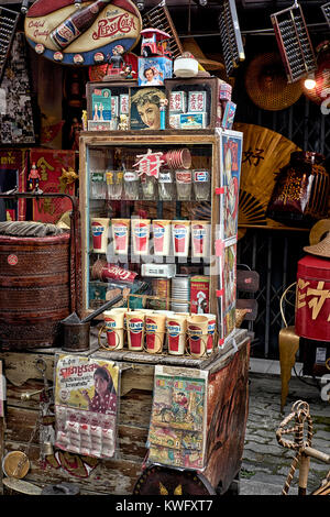 Chinatown. Vintage Chinese objects for sale at a street stall. - Stock Photo