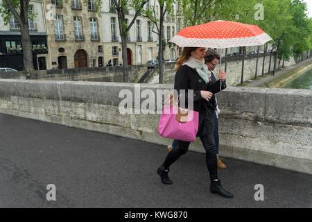 France, Paris, Walking across Pont Marie from Ile Saint Louis - Stock Photo