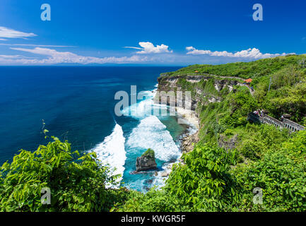 The hindu temple Pura Luhur Uluwatu situated over the cliffs of South Kuta, Bali, Indonesia - Stock Photo
