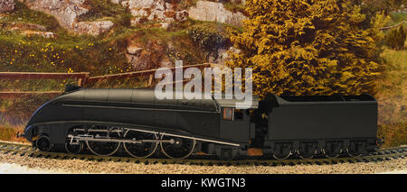 A model of an A4 locomotive in wartime colouring against a scenic backdrop. - Stock Photo