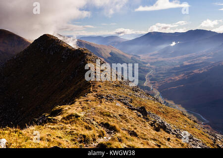 Looking eastwards along Glen Shiel from the Five Sisters of Kintail ridge on a beautiful day in October - Stock Photo