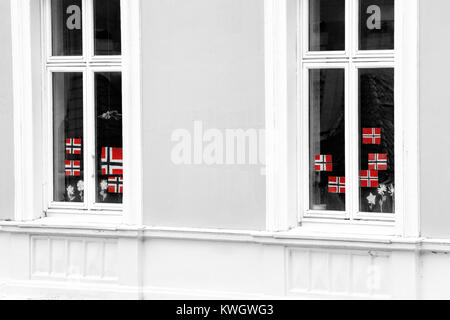 Flags of Norway in house, Bergen city - Stock Photo