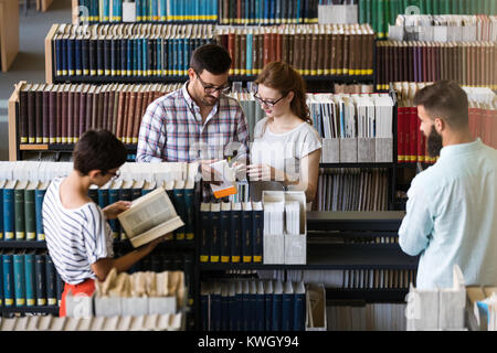 Group of college students studying - Stock Photo