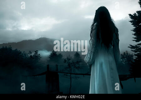 Mysterious Woman in White Dress - Stock Photo