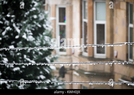 Glasgow Winter Street Scene with Focus on Electricity Supply Cables Covered in Snow - Stock Photo