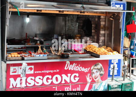 Korean street food stall in traditional market - Stock Photo