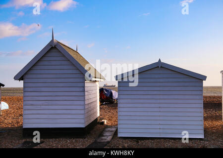 Storm Eleanor - ship seen moored from beach huts - Stock Photo
